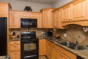 Kitchen with granite counters and plenty of cabinet storage